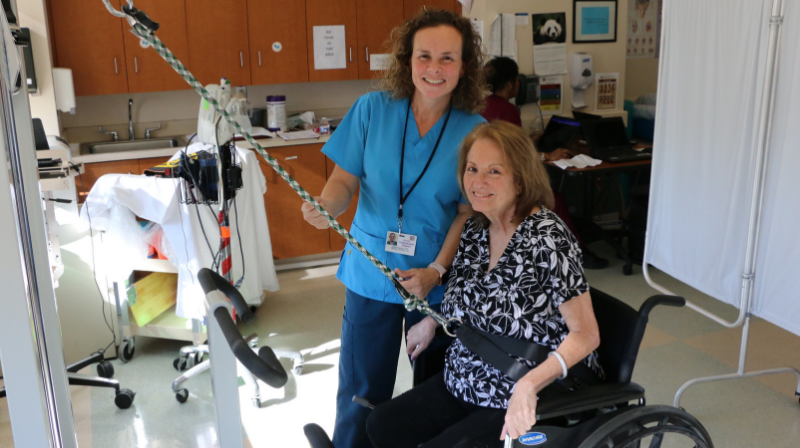 Physical Therapist working with short-term rehab patient