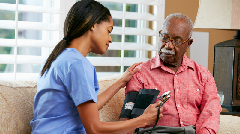 home health aid takes blood pressure